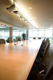 Portrait view of executive boardroom in office. Side view landscape of executive boardroom in corporate modern day clean office. Shot from perspective of Stock Photos