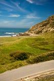 Portrait view of road leading to sandy azkorri beach Royalty Free Stock Image