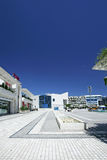 Portrait view of stunning main square in Puerto Banus, southern Spain. Portrait view of main Antonio Banderas square in Puerto Banus, southern Spain on a hot royalty free stock image