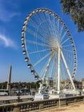 Portrait view (vertical) of Ferris wheel in central Paris at the Place de la Concorde Stock Photo
