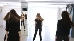 Portrait view of women changing poses in model school. stock footage