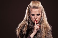 Portrait of viking woman in a traditional warrior clothes. Viking woman in a traditional warrior clothes stock image