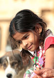Portrait of village indian girl with dog on background Royalty Free Stock Photo