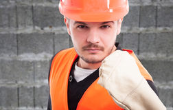 Portrait of violent constructor showing his fist. In closeup view as work trouble concept Royalty Free Stock Images