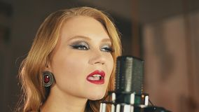 Portrait of vocalist with red lips make up perform at microphone. Retro style. Dance. Jazz artist stock video footage