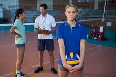 Portrait of volleyball player holding ball. In court Stock Photos
