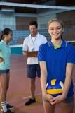 Portrait of volleyball player holding ball. In court Stock Photography