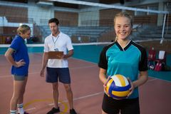 Portrait of volleyball player holding ball. In court Royalty Free Stock Photos