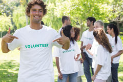 Portrait of volunteer pointing at tshirt Royalty Free Stock Image