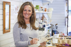 Portrait Of Volunteer Working In Charity Shop Stock Image