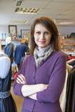 Portrait Of Volunteer Working In Charity Shop Stock Photos