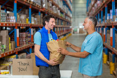 Portrait of volunteers are holding a grocery bag Royalty Free Stock Image