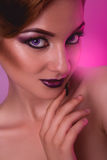 Portrait of voluptuous adult girl with make up on pink backgroun. D in studio Royalty Free Stock Images