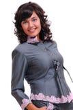 Portrait von Brunette in einer grauen Klage Lizenzfreie Stockbilder