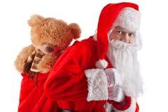 Portrait von Weihnachtsmann mit einem Beutel der Geschenke Lizenzfreie Stockbilder