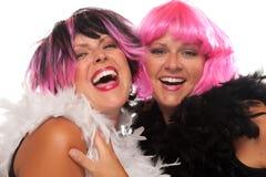 Portrait von zwei rosafarben und von schwarzen behaarten Mädchen Stockbilder