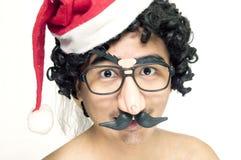 Funny man in Santa hat royalty free stock image