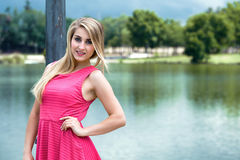 Portrait of Waist Up woman posing next to river Royalty Free Stock Photo