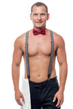 Portrait of a waiter in a bow tie and suspenders Stock Image