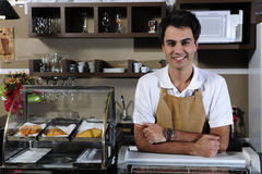 Portrait of a waiter at the cafe stock image