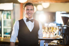 Portrait of waiter holding serving tray with champagne flutes . In restaurant Royalty Free Stock Photography