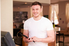 Portrait Of Waiter In Hotel Using Digital Tablet Royalty Free Stock Photos