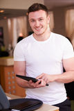 Portrait Of Waiter In Hotel Using Digital Tablet Royalty Free Stock Photo