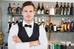Portrait of waiter standing at bar counter. In restaurant Royalty Free Stock Photography