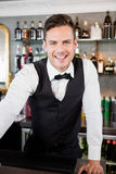 Portrait of waiter standing at bar counter. In restaurant Stock Photography