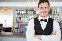Portrait of waiter standing at bar counter. In restaurant Stock Photos