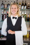 Portrait of waiter standing at bar counter. In restaurant Royalty Free Stock Photo