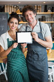 Portrait of waiter and waitress holding digital tablet Stock Image