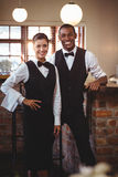 Portrait of waiter and waitress standing together Stock Photo
