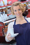 Portrait waitress holding cup Royalty Free Stock Photo