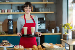 Portrait of waitress holding cup of cold coffee Stock Photography