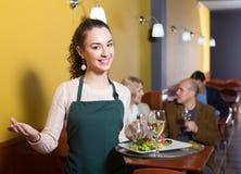 Portrait of waitress holding tray Stock Image