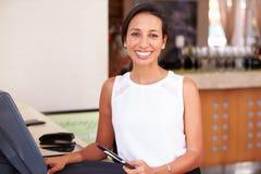 Portrait Of Waitress In Hotel Restaurant Preparing Bill Royalty Free Stock Image