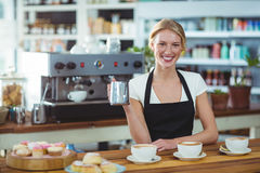 Portrait of waitress making cup of coffee at counter Royalty Free Stock Images