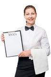 Portrait of a waitress with menu isolated in the studio Royalty Free Stock Photo