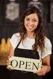 Portrait of a waitress showing open sign Stock Image