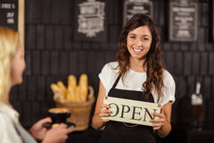 Portrait of a waitress showing open sign Royalty Free Stock Images