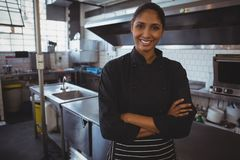 Portrait of waitress standing in cafe. Portrait of smiling young waitress standing in cafe Stock Image