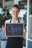 Portrait of waitress standing with chalkboard Royalty Free Stock Photos