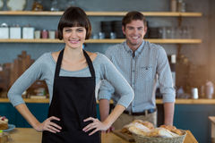 Portrait of waitress standing with hand on hip Stock Photos