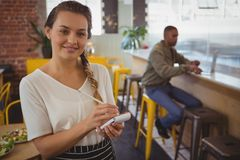 Portrait of waitress taking order by businessman Stock Photography