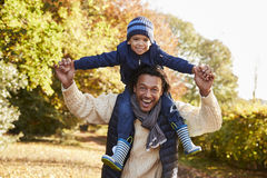 Portrait Of Walk With Father Carrying Son On Shoulders Stock Photos