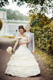 Portrait of walking newlyweds Stock Photo