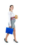 Portrait of walking pregnant businesswoman with document case an Stock Image