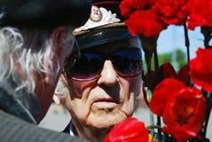 Portrait of a war veteran. Carnation flowers. Stock Photo