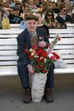 Portrait of a war veteran holding flowers. Stock Photo
